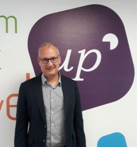Stephane Baudouin, Data Architect posing within UpCRM premises